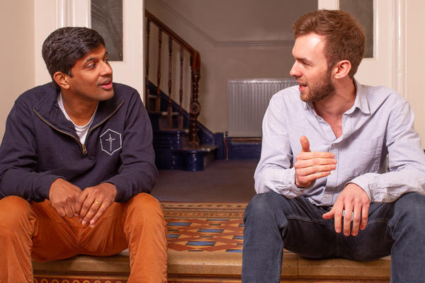 Photo of students talking in a Wycliffe Hall corridor