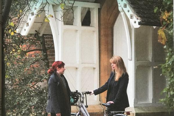 The Wycliffite front cover with 2 students and a bike