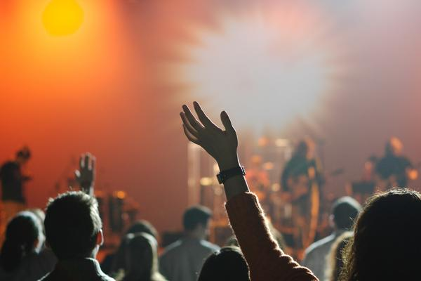 Photo of hands raised at a concert