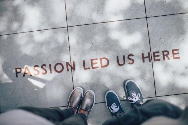 Passion Led Us Here written on the floor