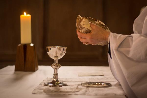 Breaking bread at communion