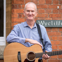 David Clifton in front of Wycliffe Hall sign